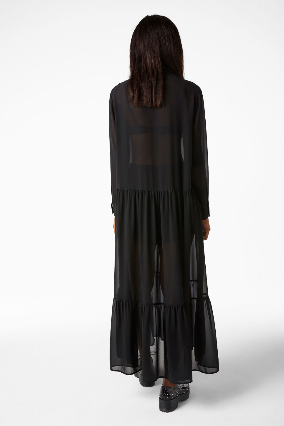 Model back image of Monki long dress with ruffle hem in black