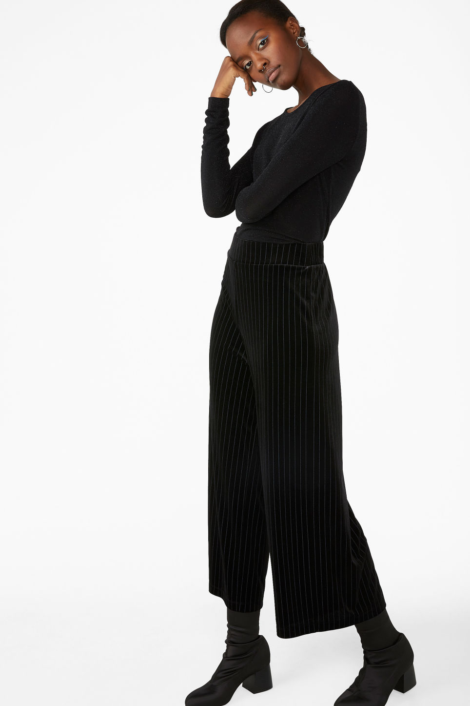 Model side image of Monki long-sleeved glitter top in black
