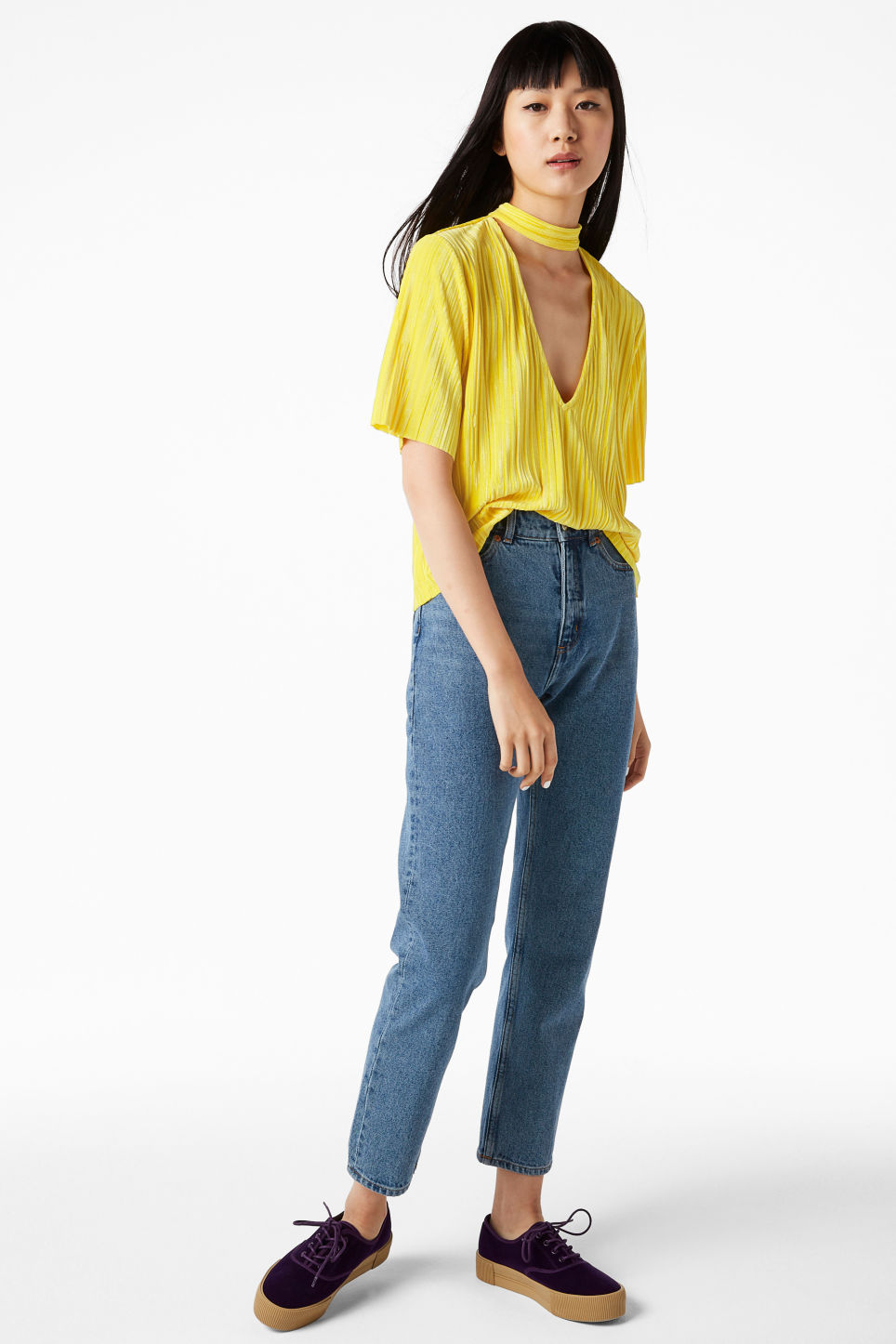 Model side image of Monki v-neck blouse with neck band in yellow