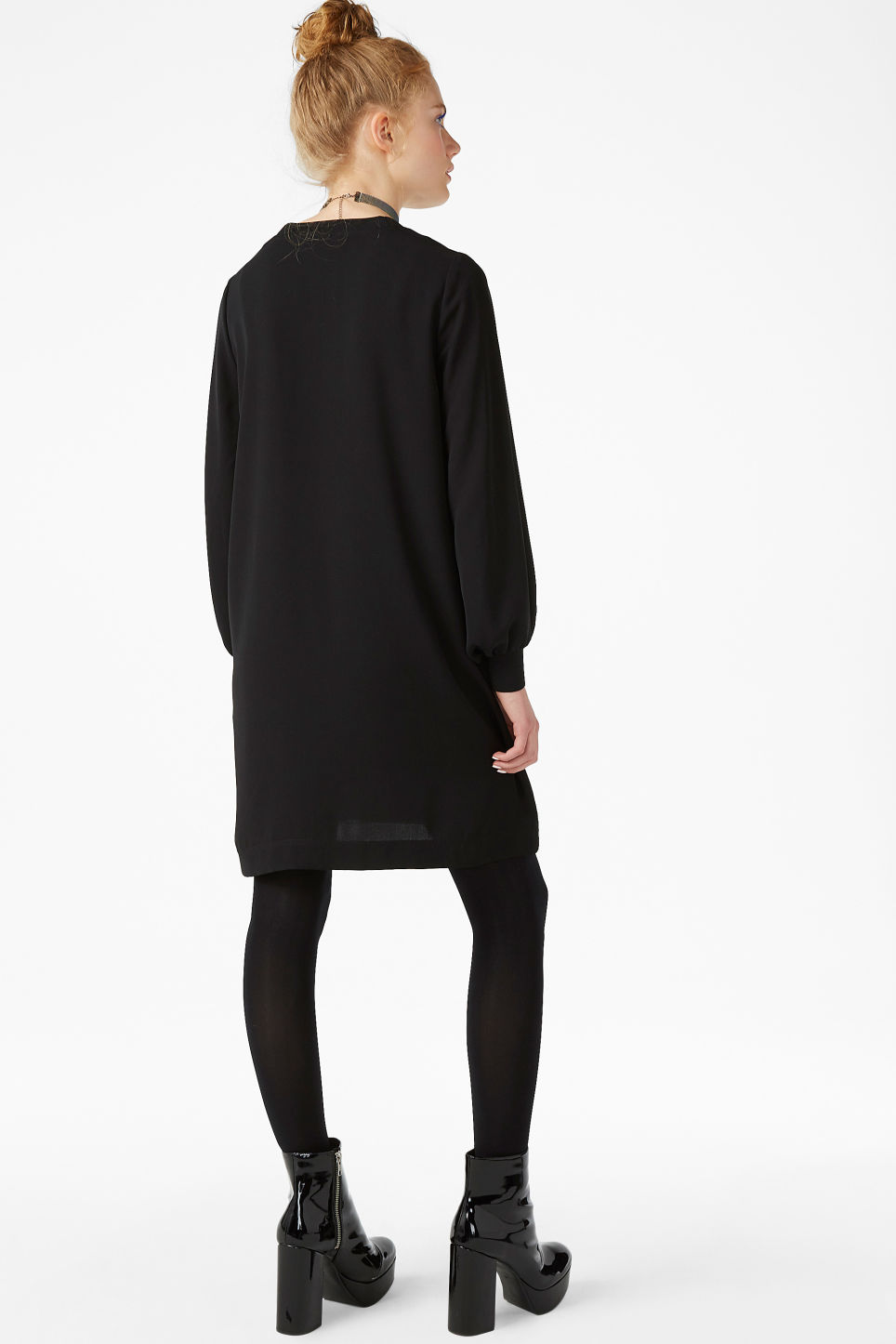 Model back image of Monki puff-sleeved dress in black