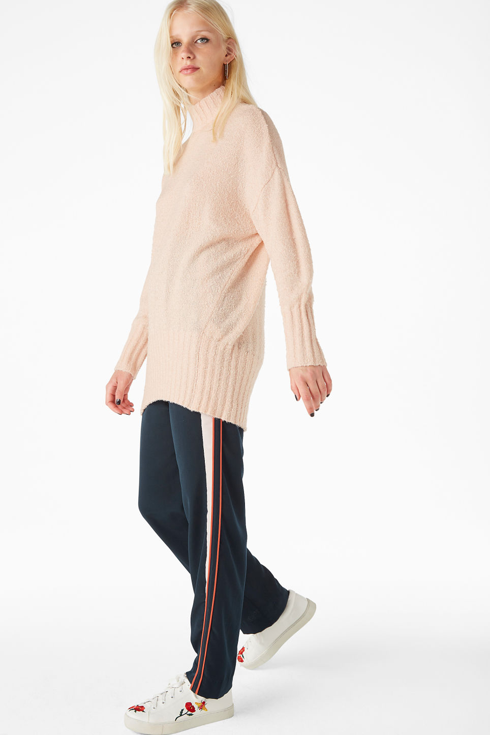 Model side image of Monki cosy knitted sweater in orange