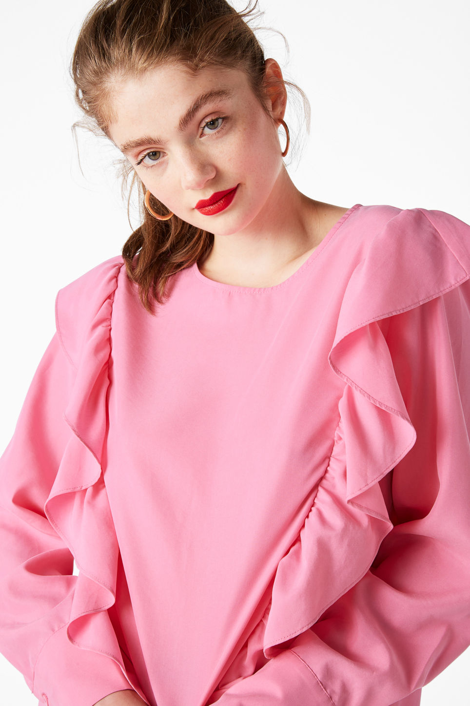Model front image of Monki ruffled mullet hem blouse in pink
