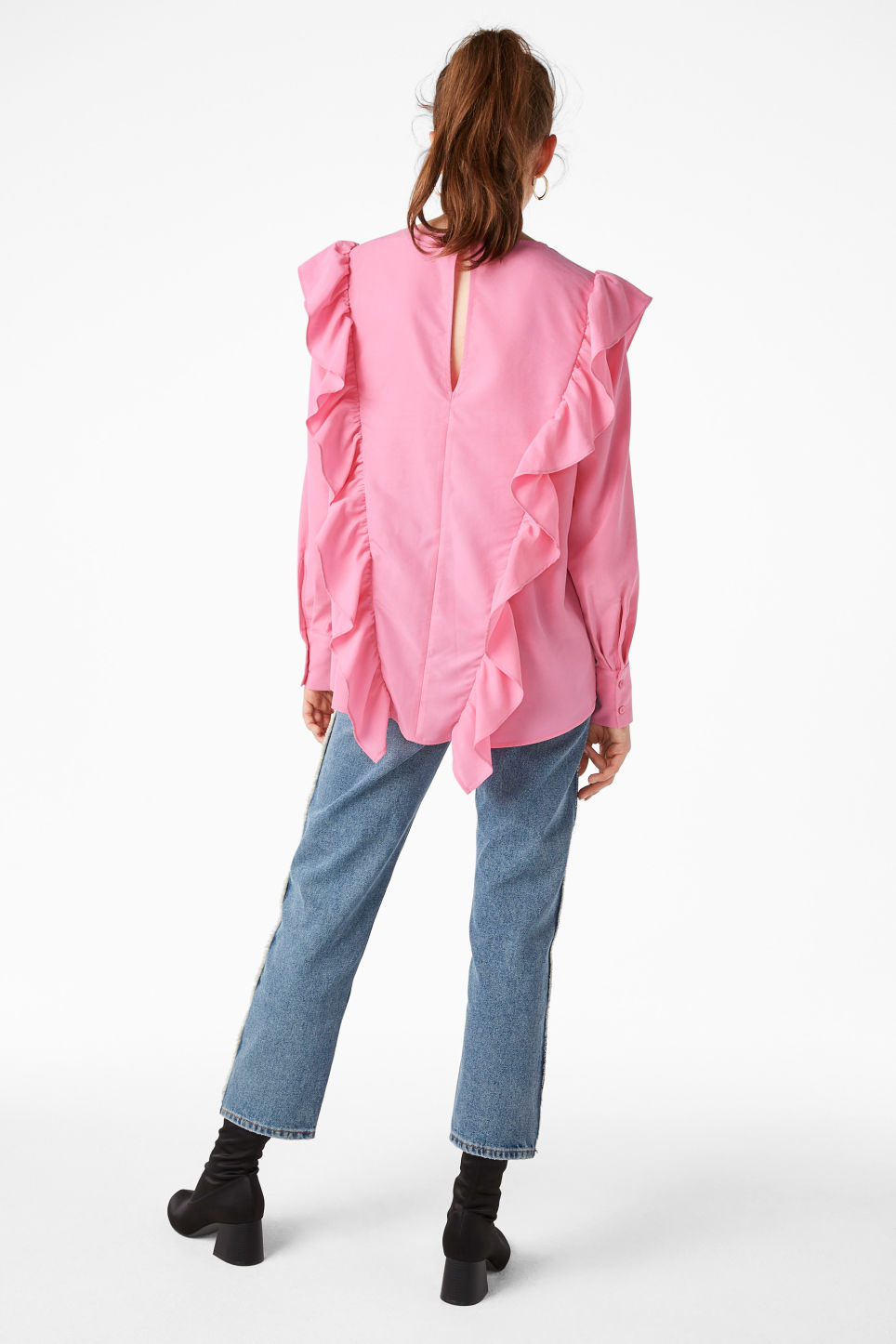 Model back image of Monki ruffled mullet hem blouse in pink