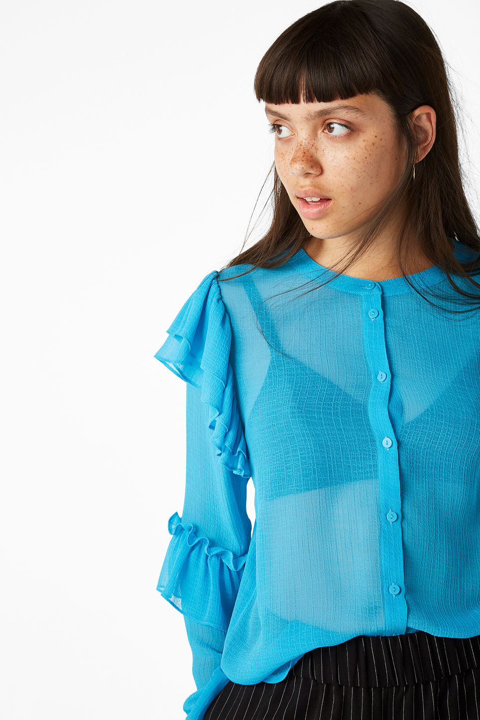 Model front image of Monki triple ruffled sleeve blouse in turquoise
