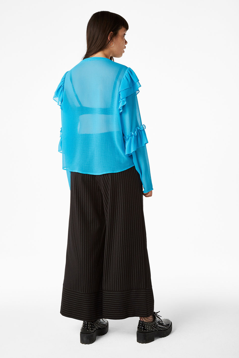 Model back image of Monki triple ruffled sleeve blouse in turquoise