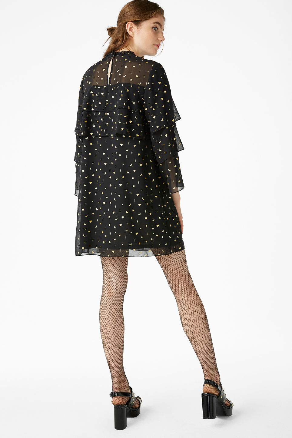 Model back image of Monki ruffled trumpet sleeved dress in black