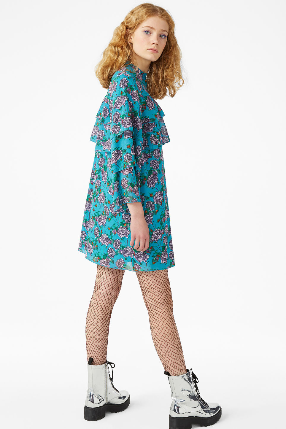 Model side image of Monki ruffled trumpet sleeved dress in turquoise