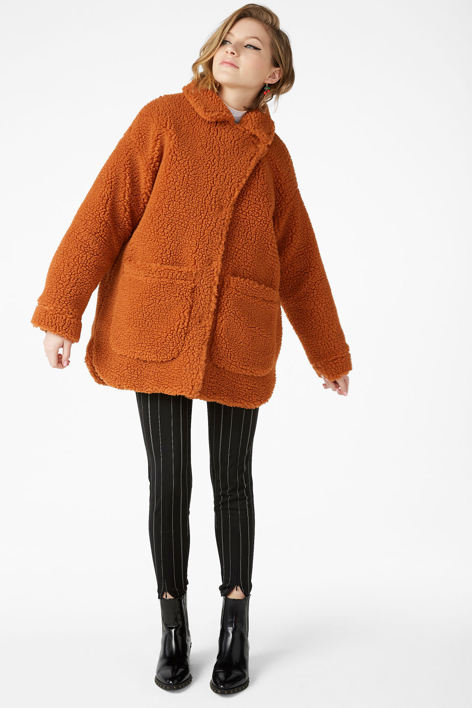 Model front image of Monki faux shearling coat in orange