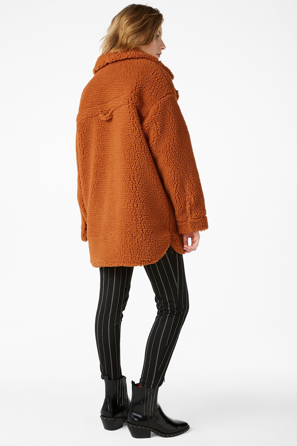 Model back image of Monki faux shearling coat in orange
