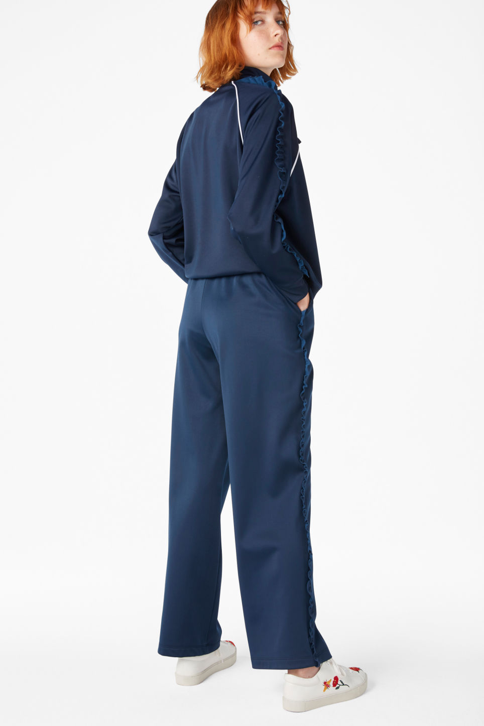 Model back image of Monki frill track trousers in blue