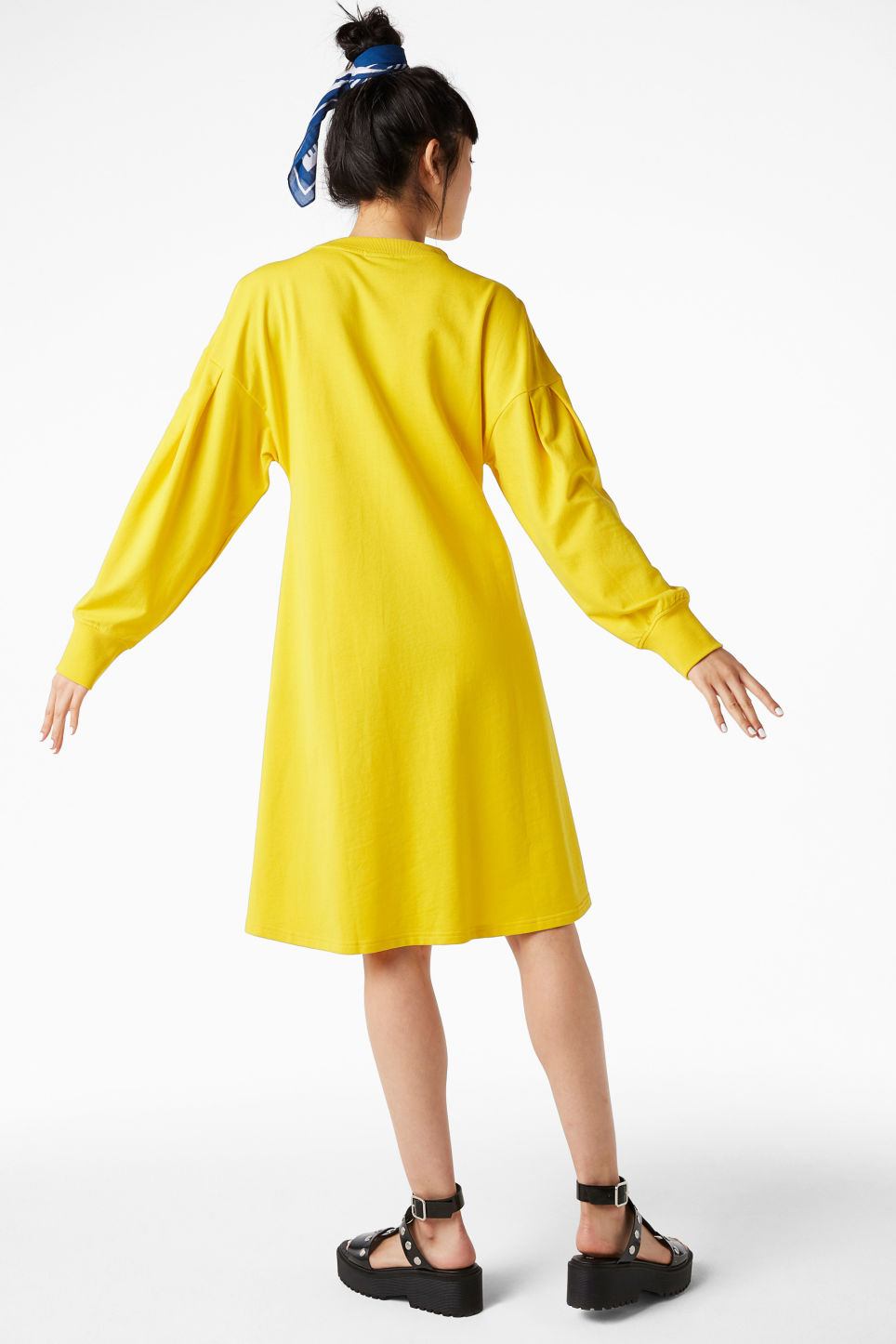 Model back image of Monki puff-sleeved sweater dress in yellow