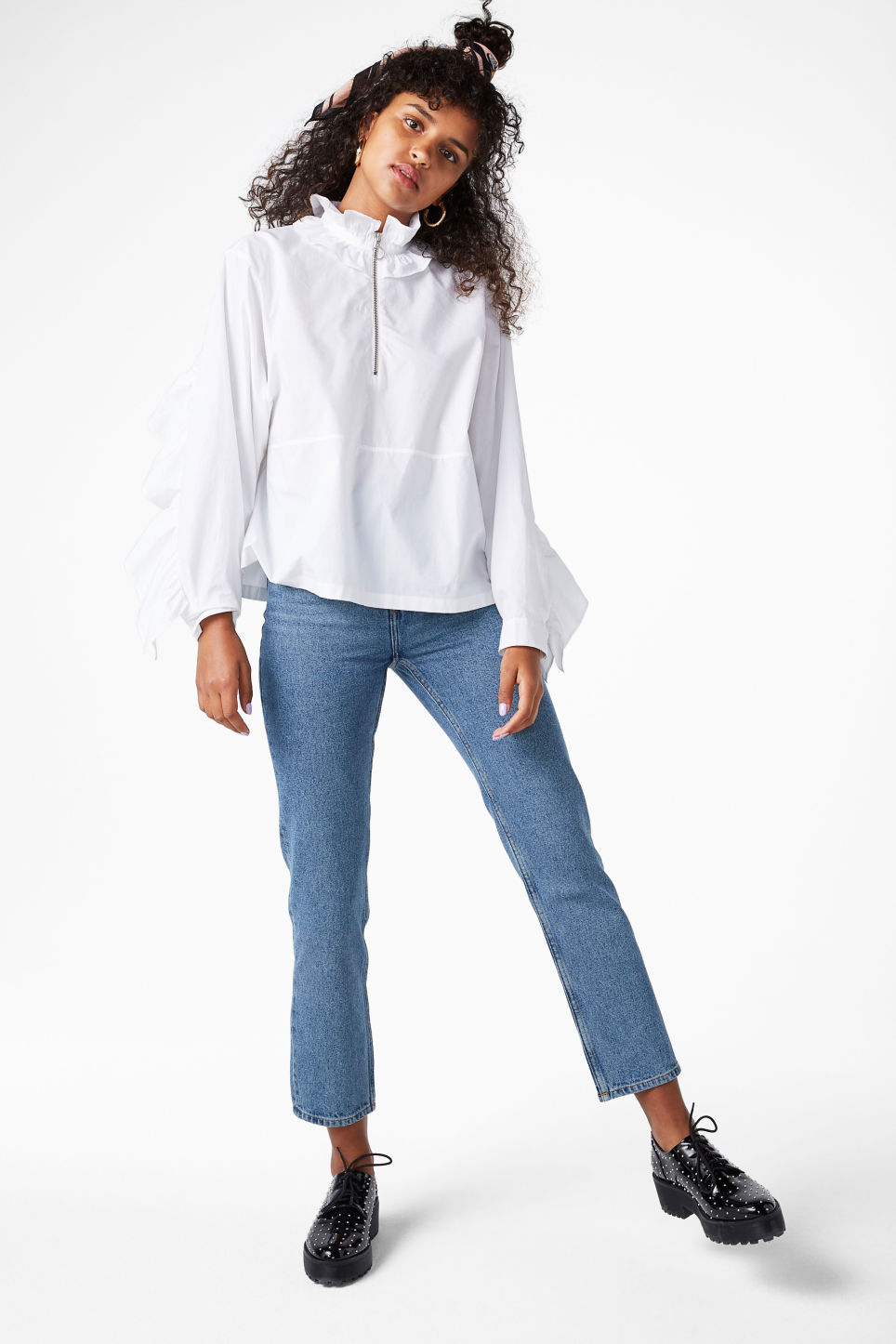 Model front image of Monki ruffled zip neck blouse in white