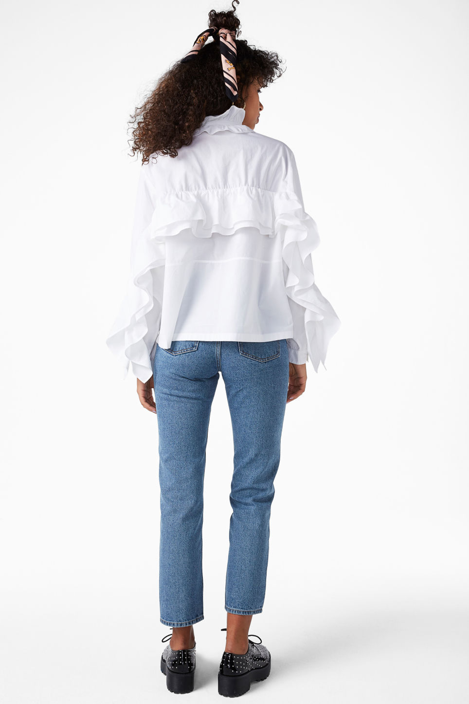 Model back image of Monki ruffled zip neck blouse in white