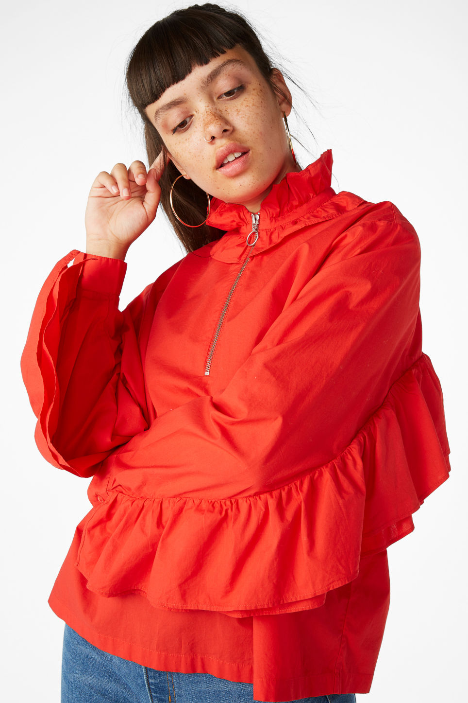 Model front image of Monki ruffled zip neck blouse in red