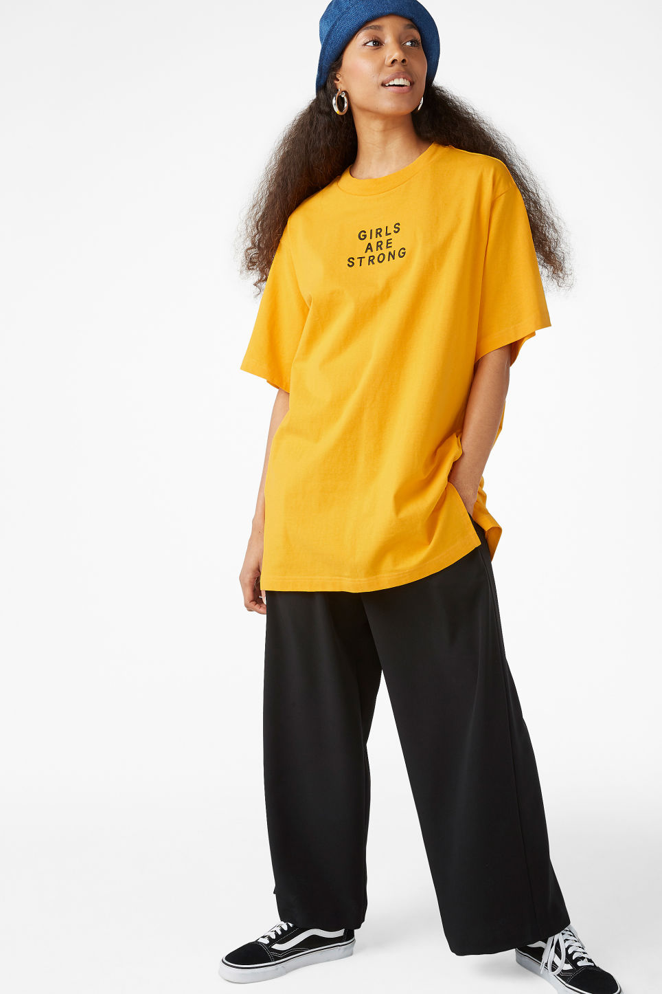 Model side image of Monki oversized cotton tee in yellow