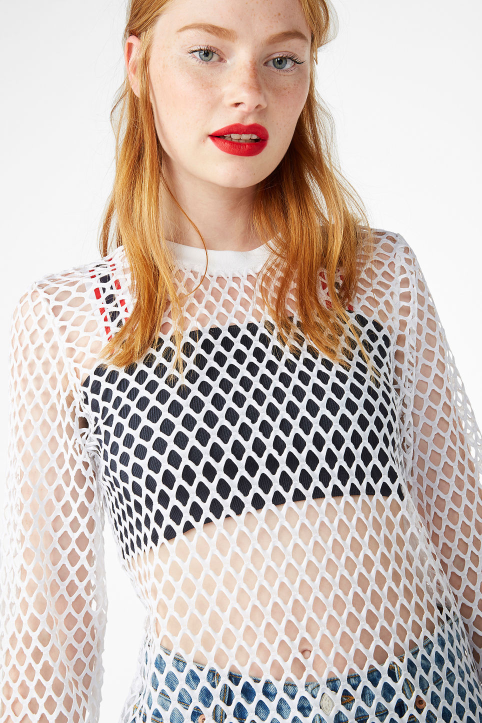 Model front image of Monki long fishnet top in white