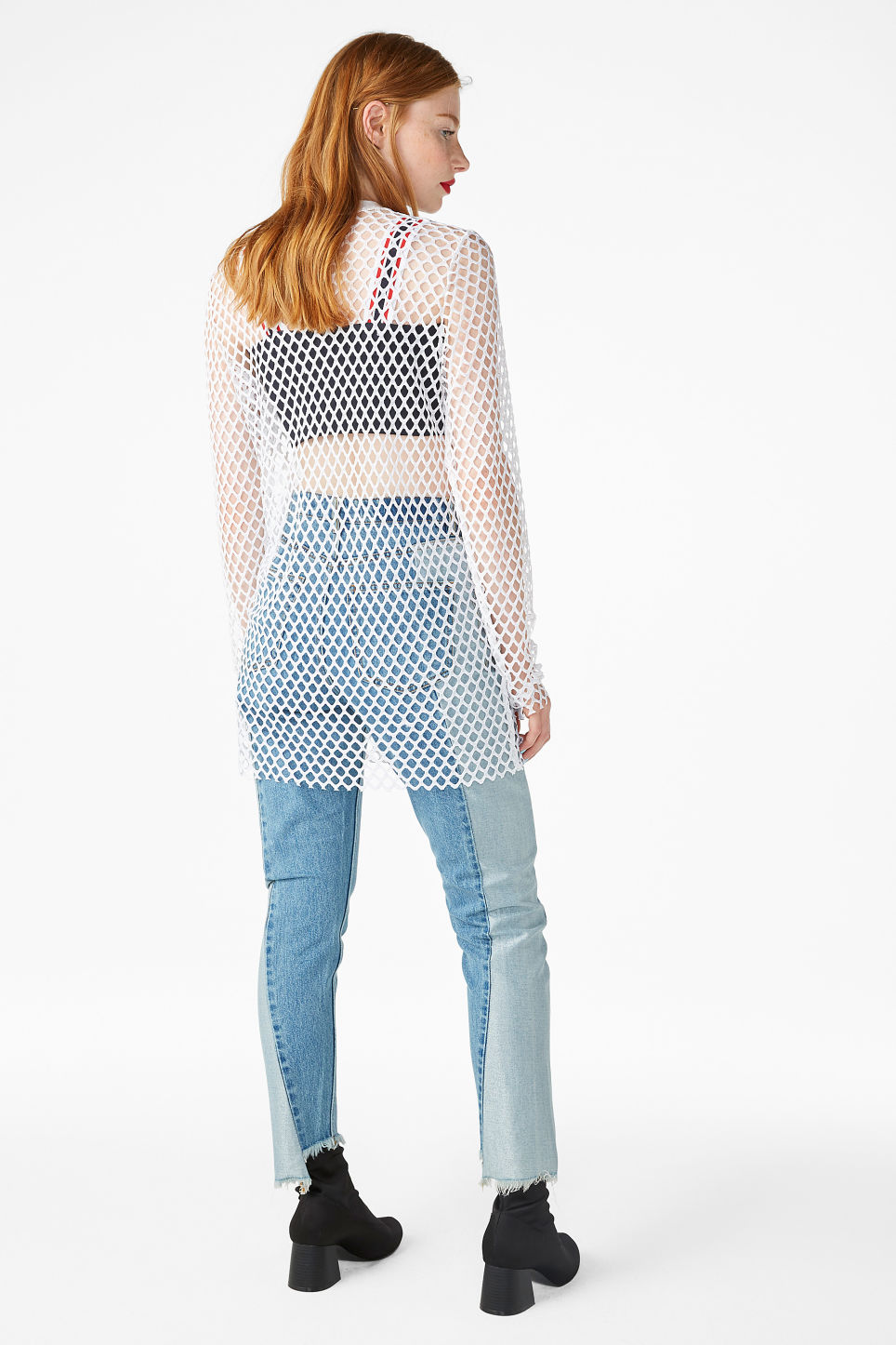 Model back image of Monki long fishnet top in white