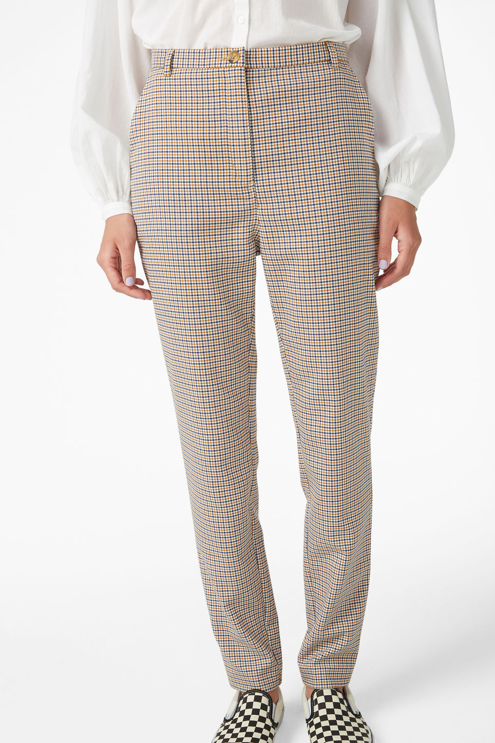 Model side image of Monki dressy tapered trousers in yellow