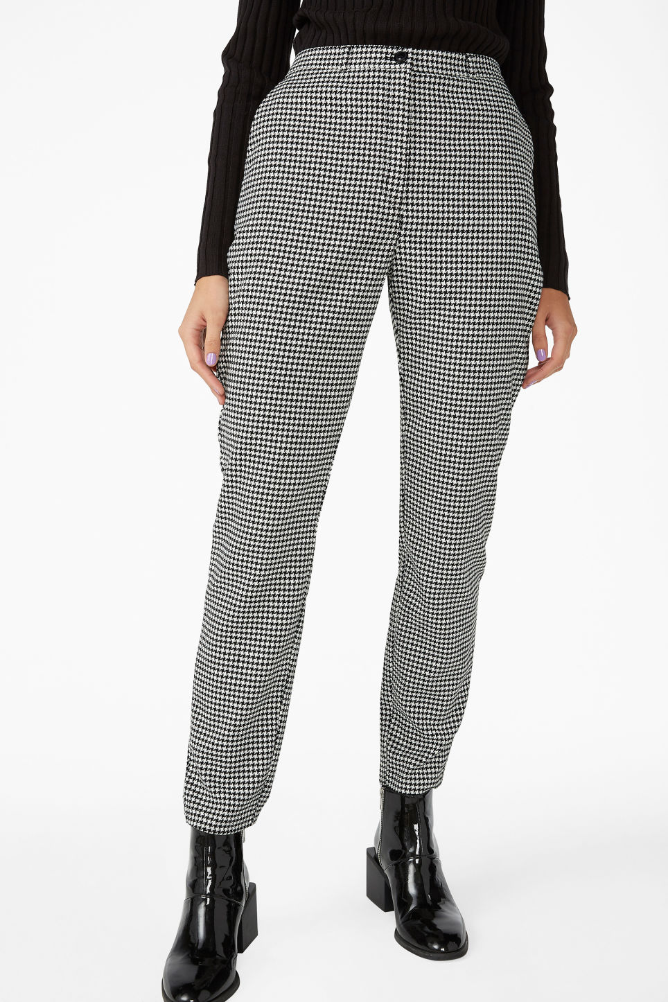 Model side image of Monki dressy tapered trousers in white