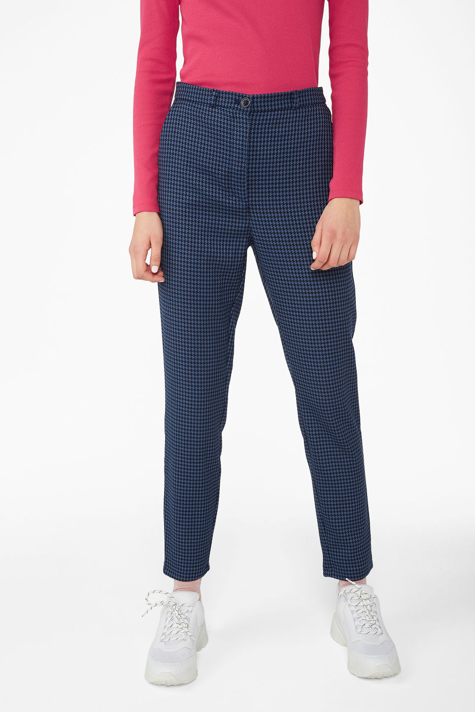 Model side image of Monki dressy tapered trousers in blue