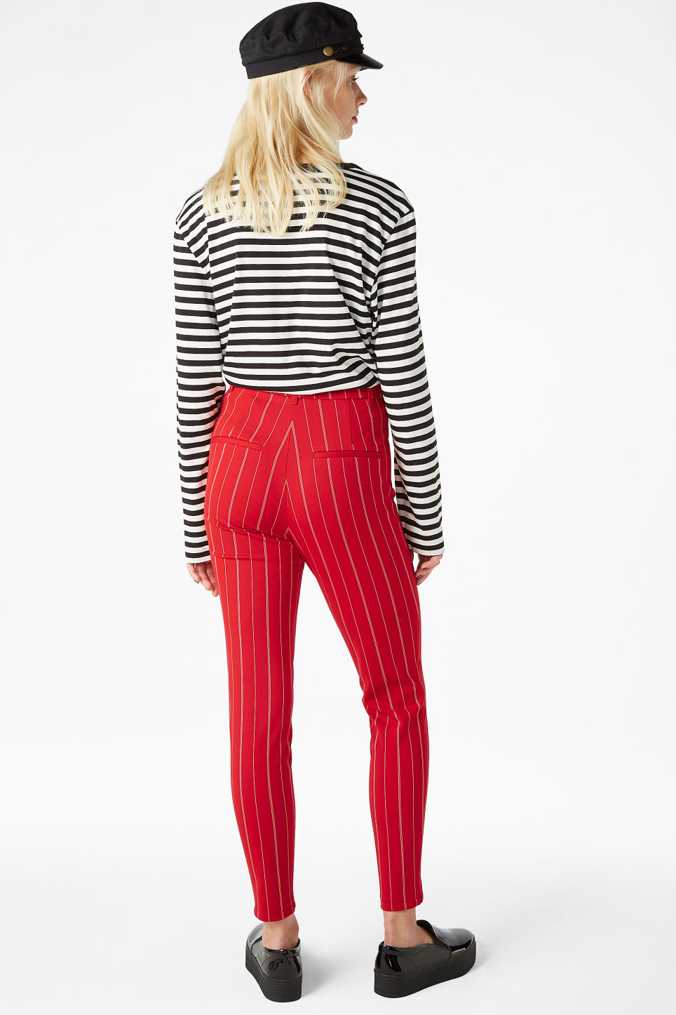 Model back image of Monki stretchy striped trousers in red