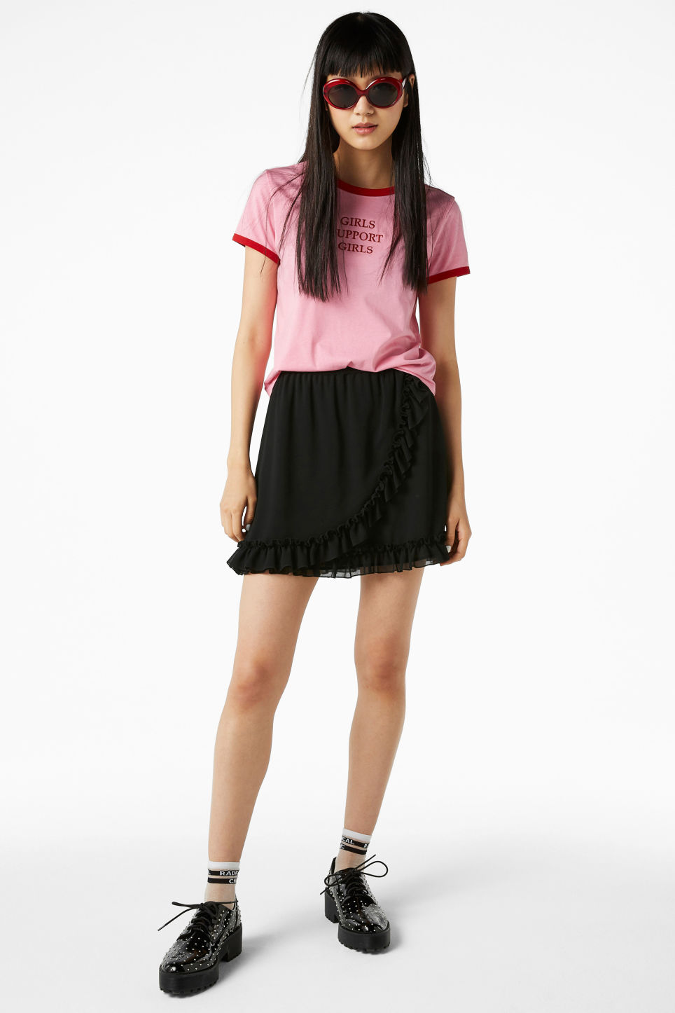 Model front image of Monki ruffled wrap front skirt in black