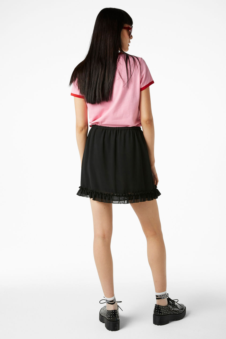 Model back image of Monki ruffled wrap front skirt in black