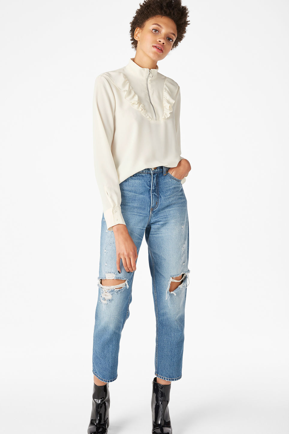 Model front image of Monki ruffle zip up blouse in white