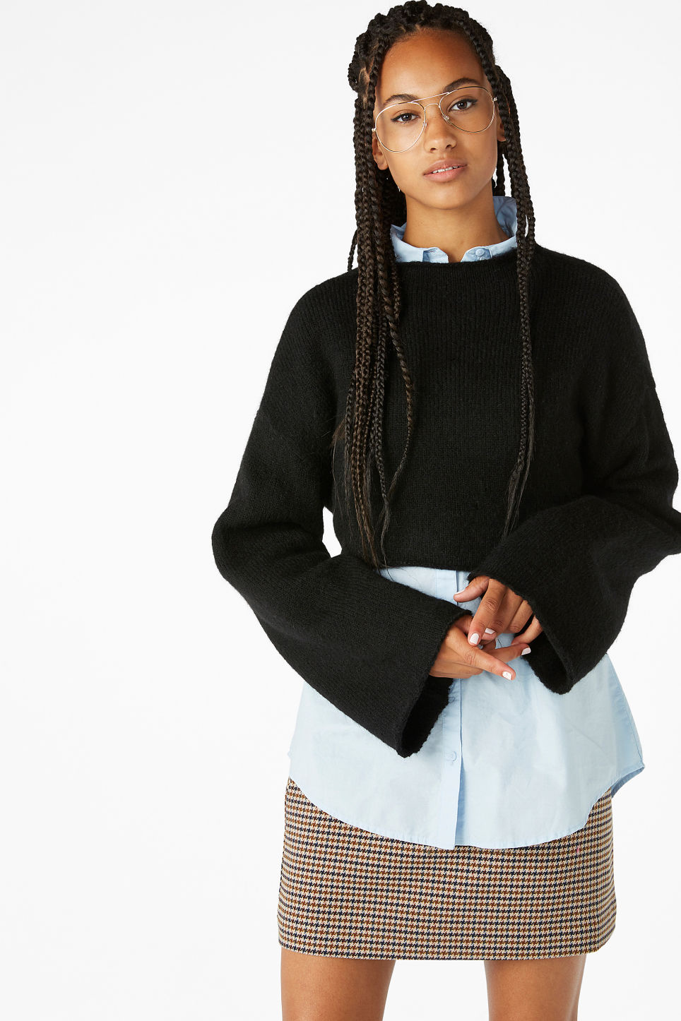 Model front image of Monki cropped bell sleeve sweater in black