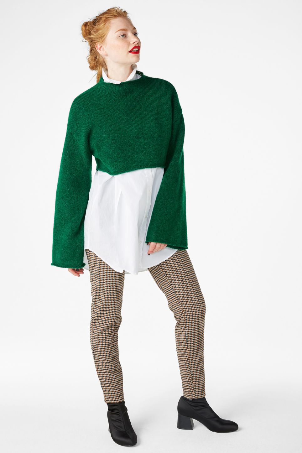 Model front image of Monki cropped bell sleeve sweater in green