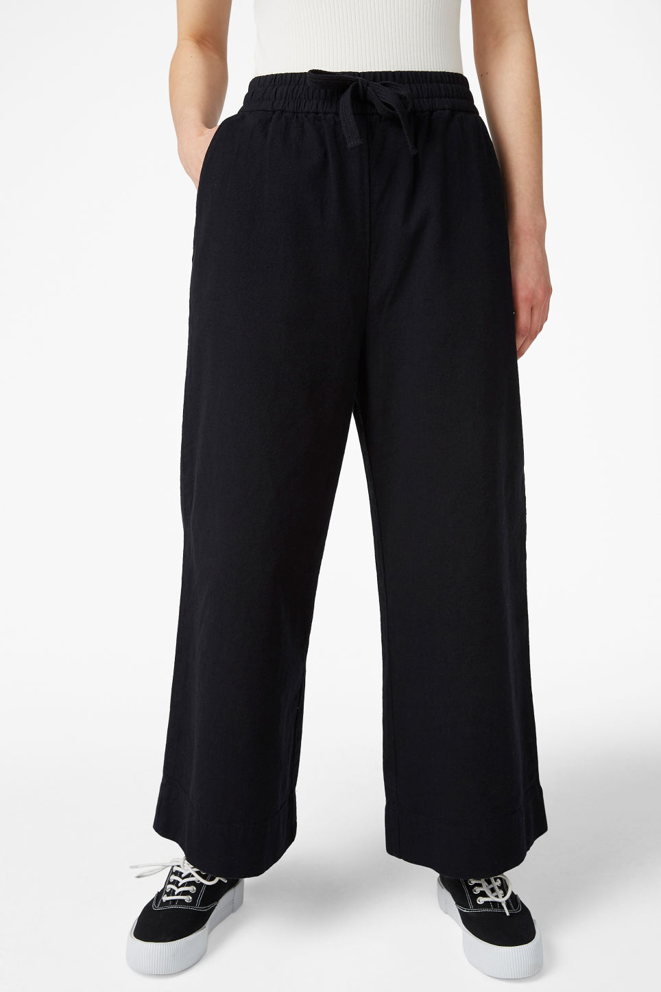 Model side image of Monki wide leg canvas trousers in black