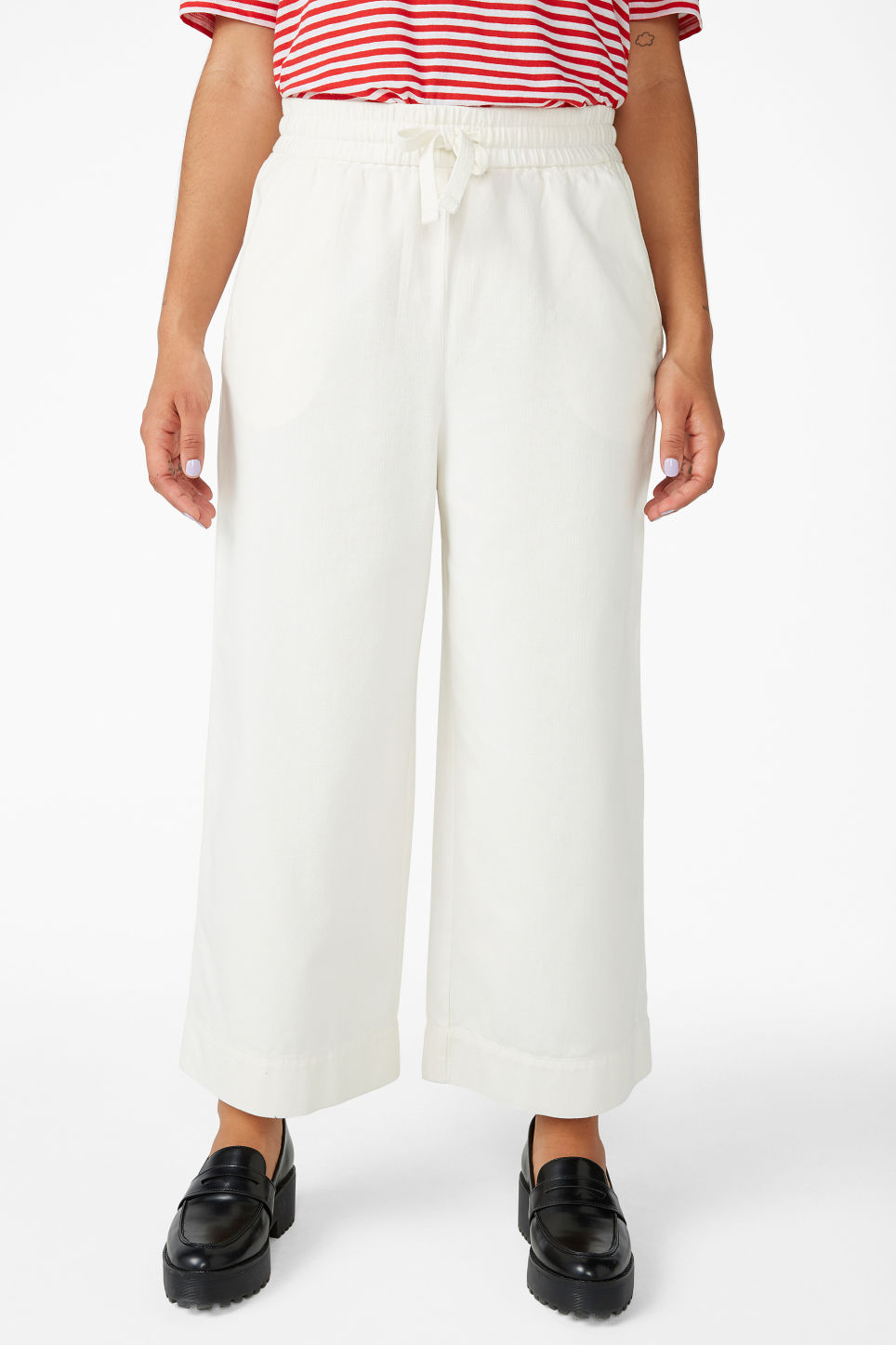 Model side image of Monki wide leg canvas trousers in white