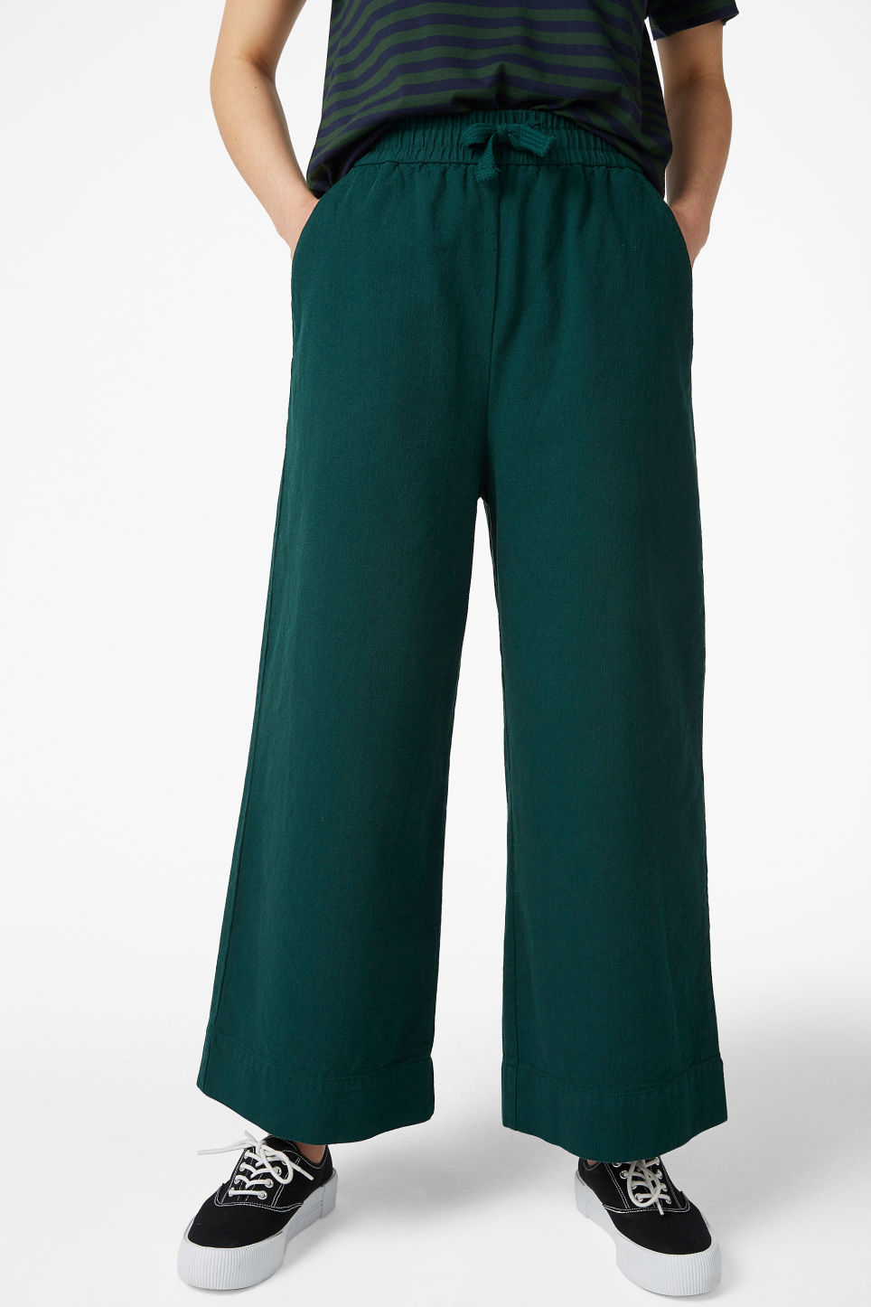 Model side image of Monki wide leg canvas trousers in green