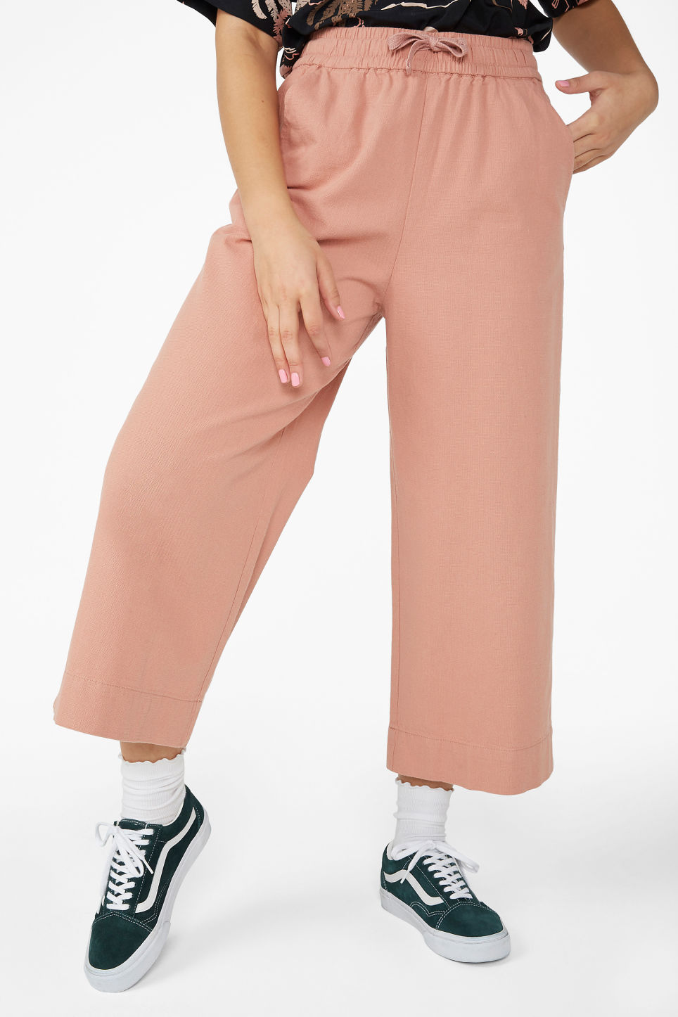 Model side image of Monki wide leg canvas trousers in pink