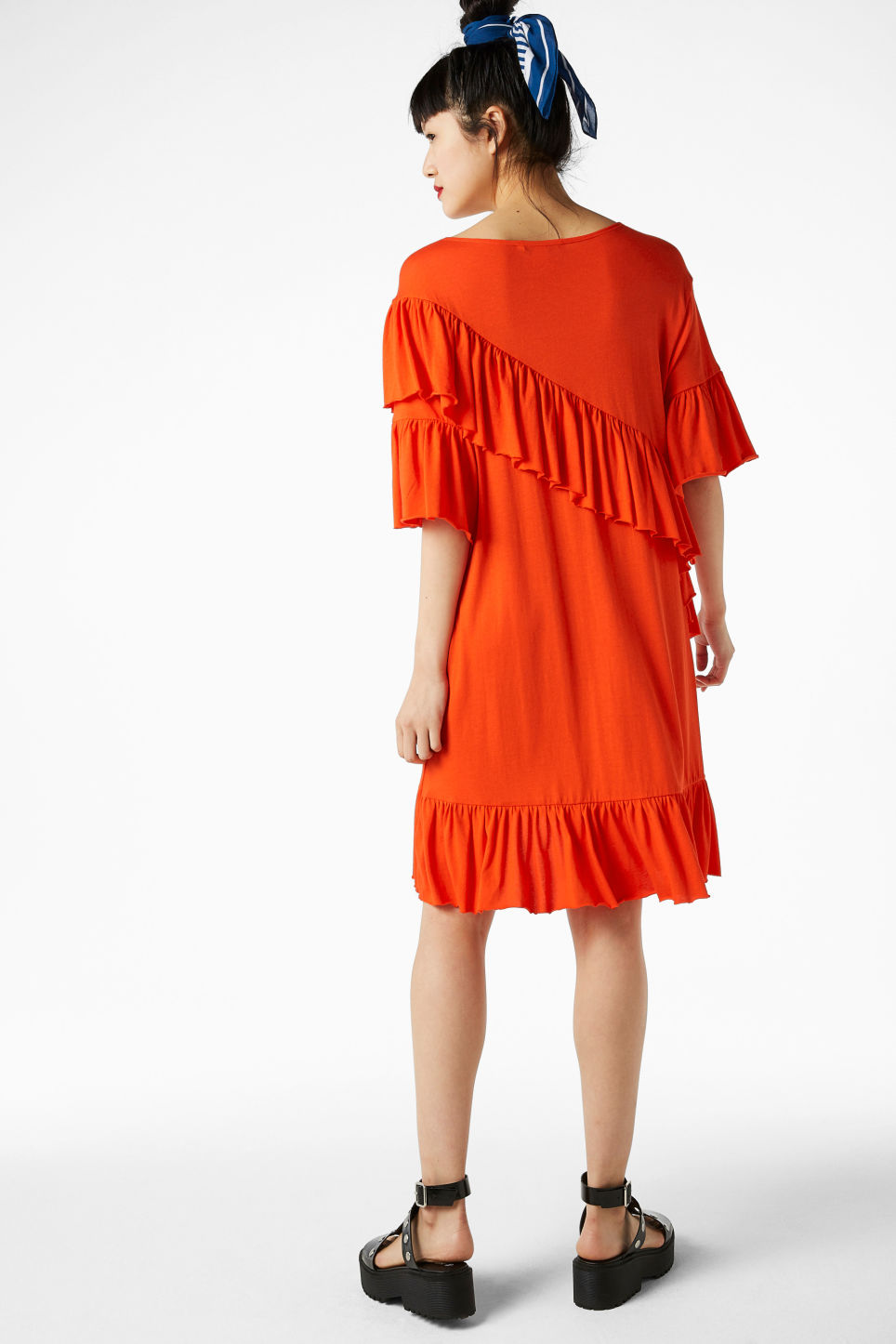 Model back image of Monki soft ruffled dress in orange