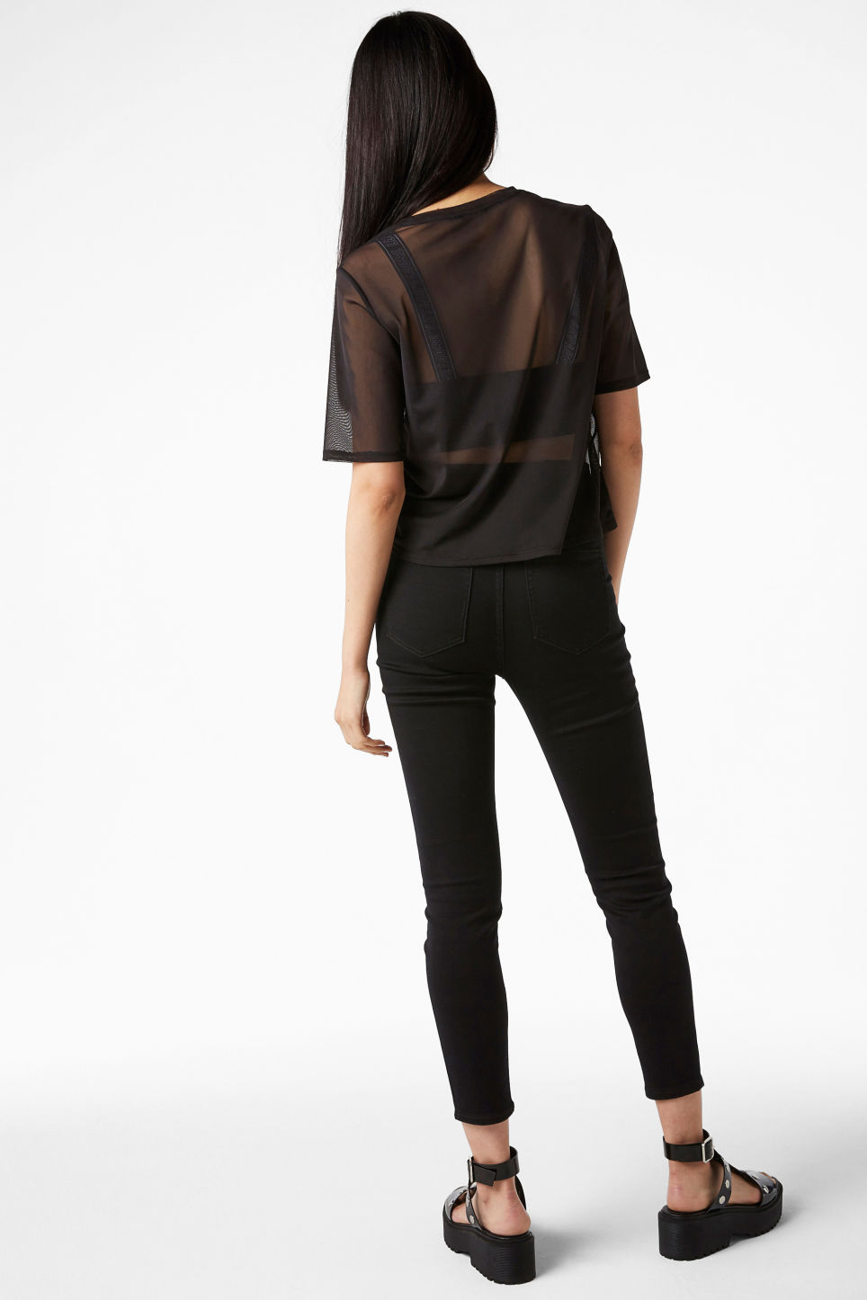Model back image of Monki mesh top in black