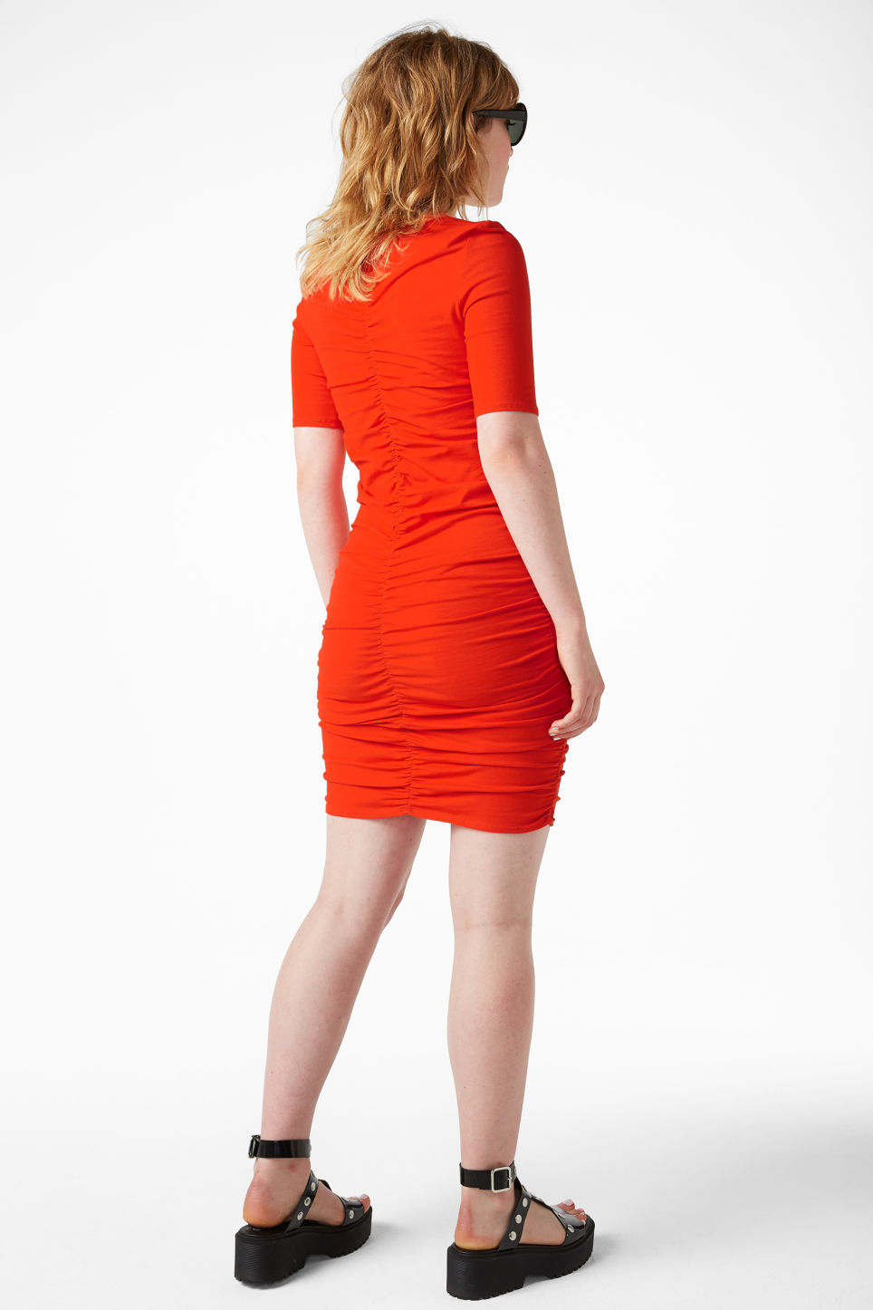 Model side image of Monki ruched detail dress in red