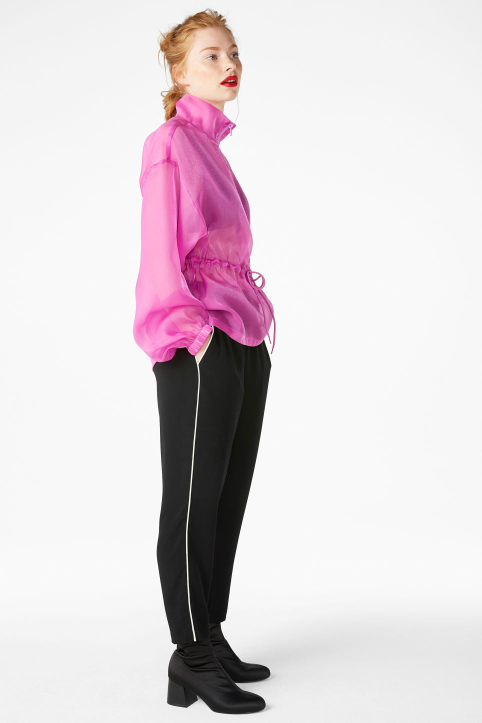 Model side image of Monki sheer scuba neck blouse in pink