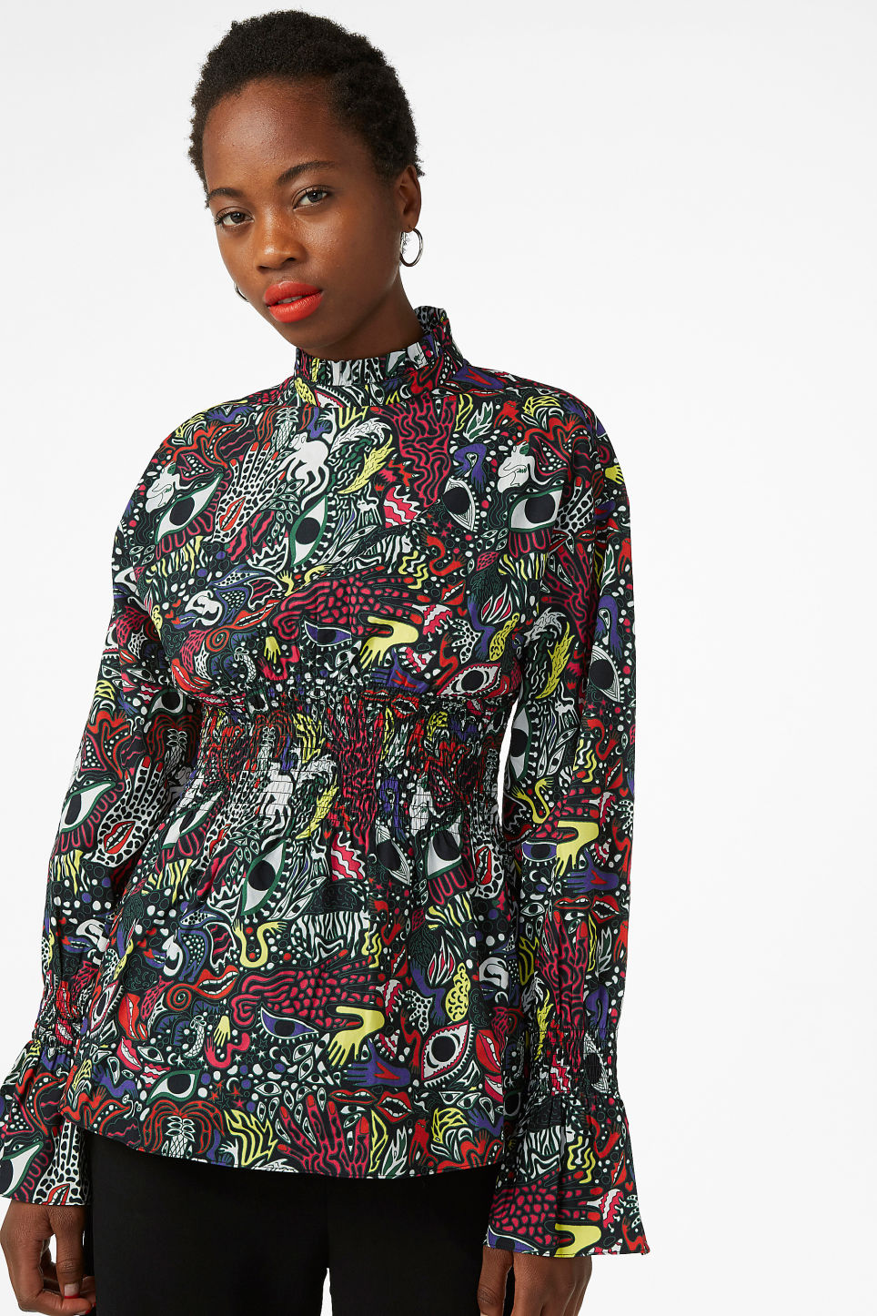 Model front image of Monki smocked print blouse in black
