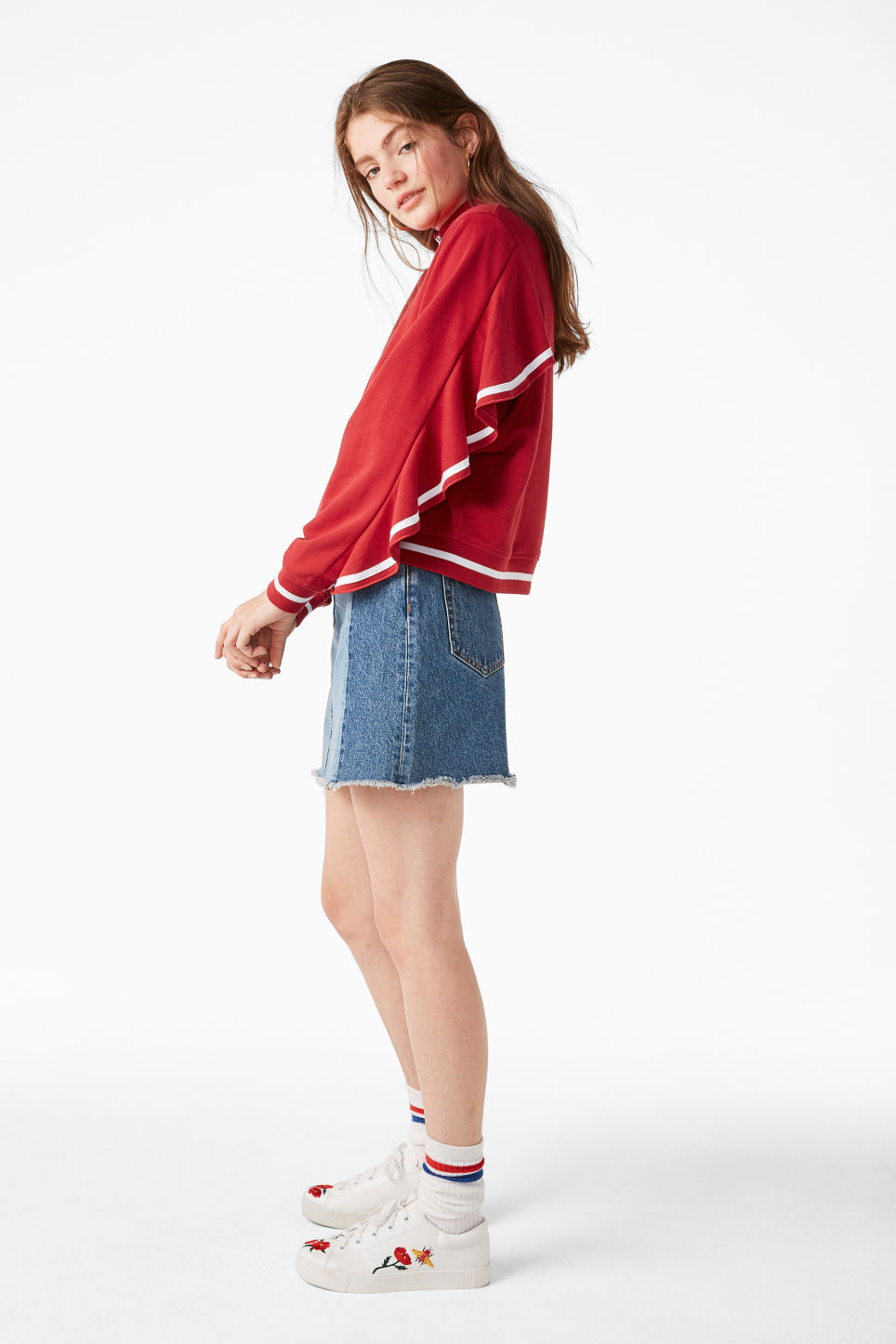 Model side image of Monki zip ruffle jacket in red