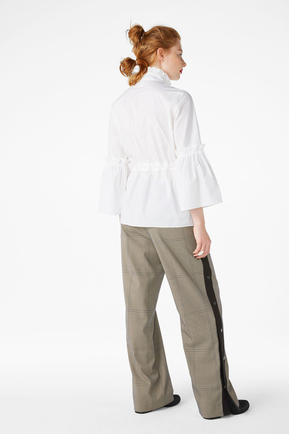Model side image of Monki high neck trumpet sleeve blouse in white