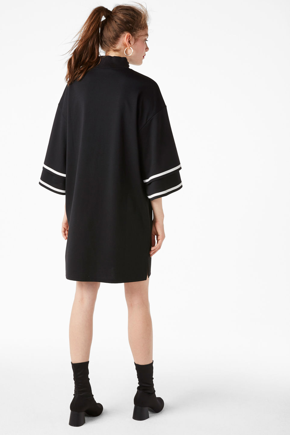 Model back image of Monki ruffled bell sleeve dress in black
