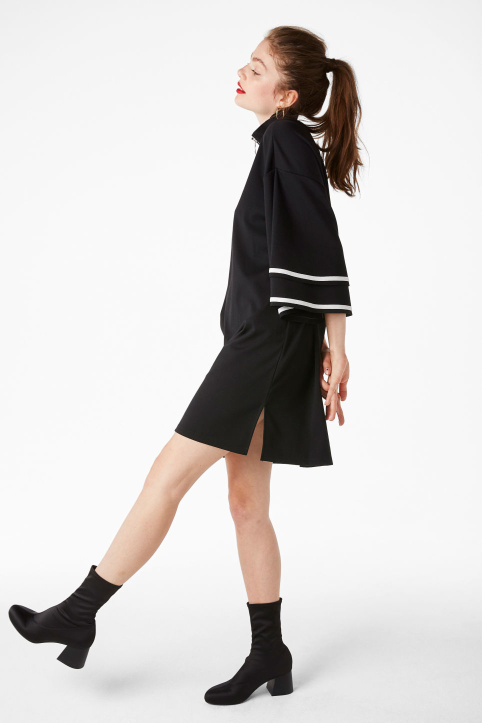 Model side image of Monki ruffled bell sleeve dress in black