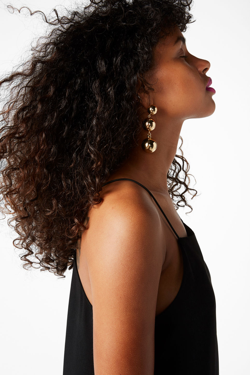 Model front image of Monki gold drop earrings in gold