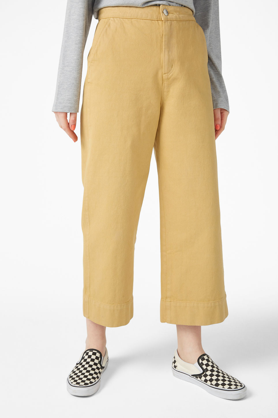 Model side image of Monki wide denim trousers in yellow