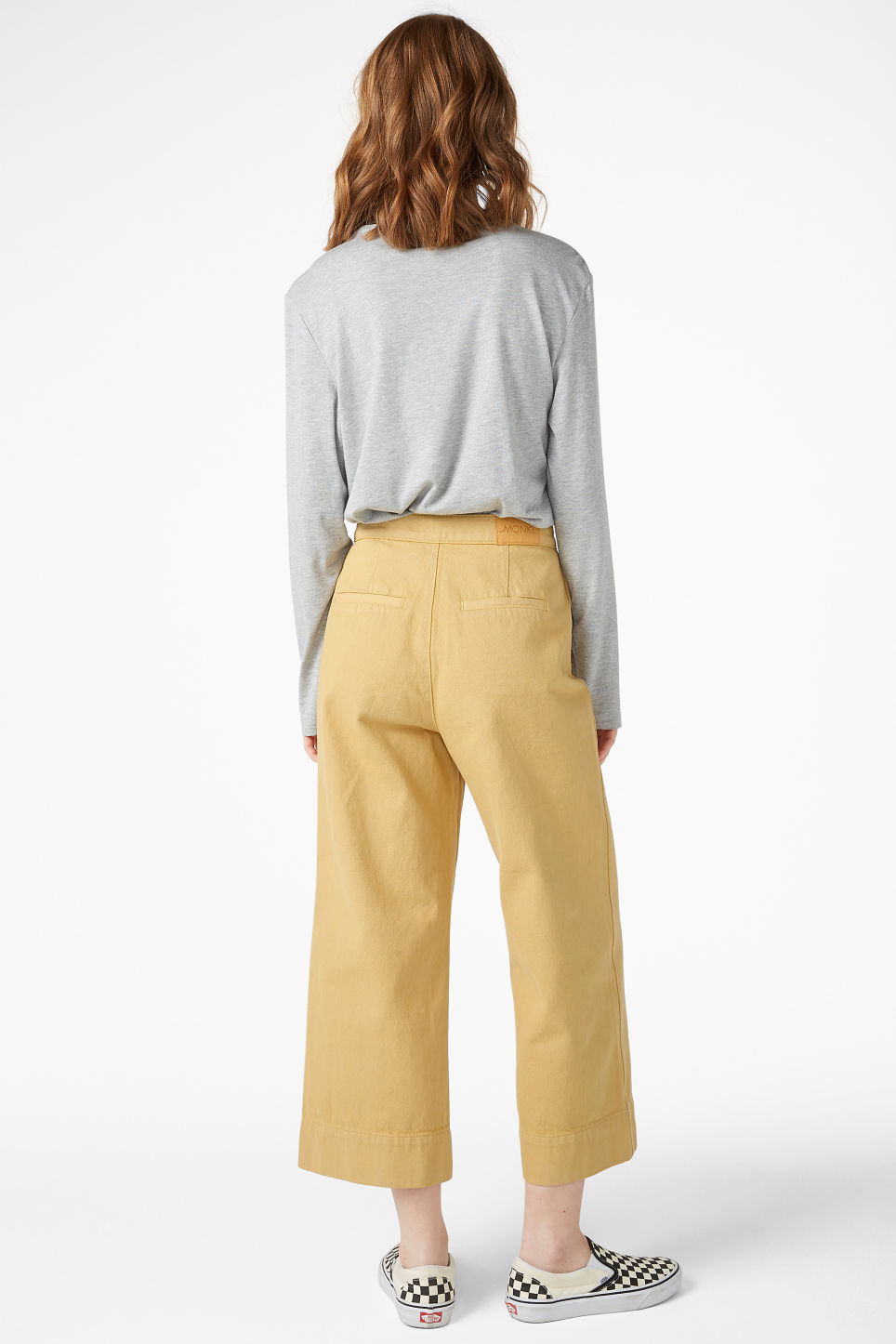 Model back image of Monki wide denim trousers in yellow