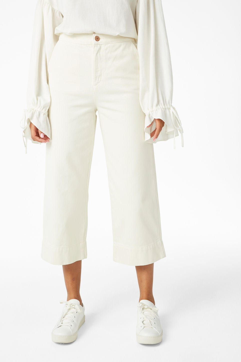 Model side image of Monki wide denim trousers in white