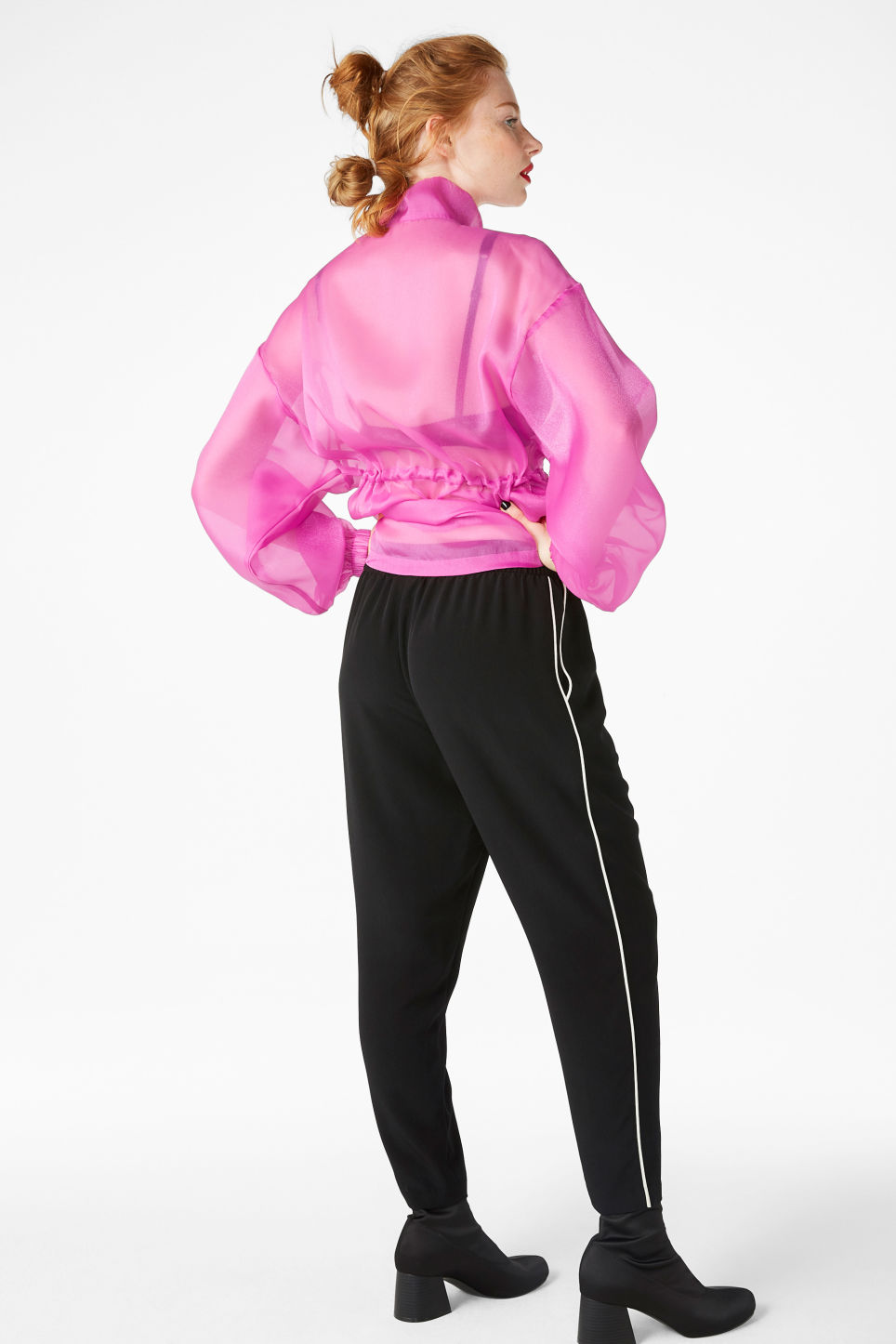 Model side image of Monki cropped trousers in black