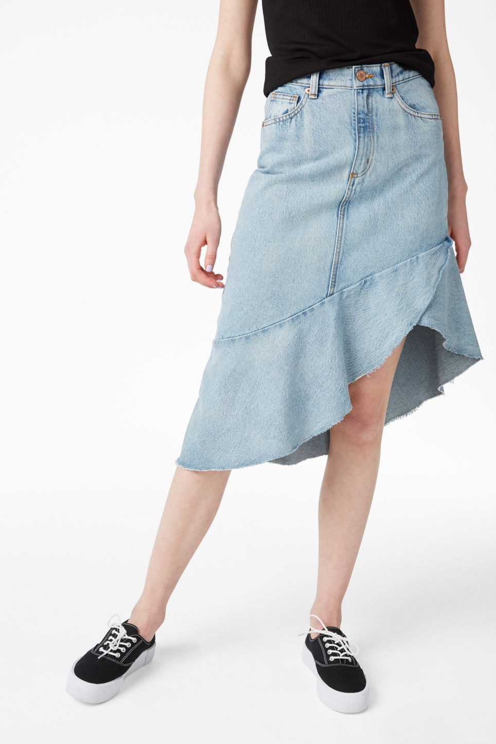 Model side image of Monki denim skirt in blue