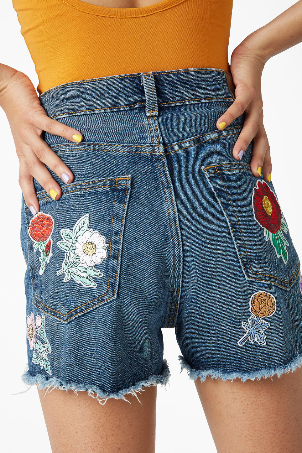 Model front image of Monki embroidered patches in red